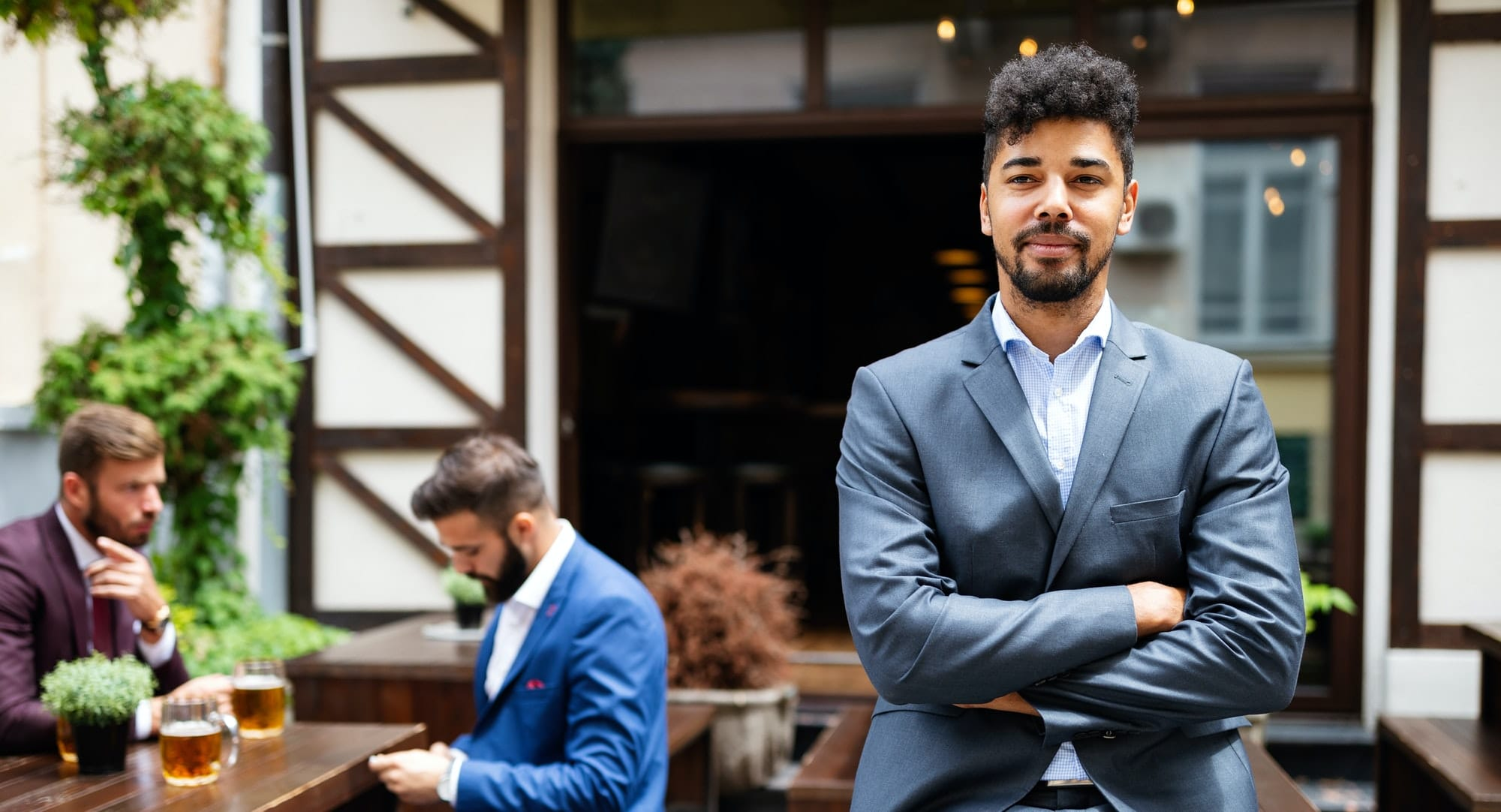 Young male business owner standing near his new local. Startup, entrepreneur, business concept