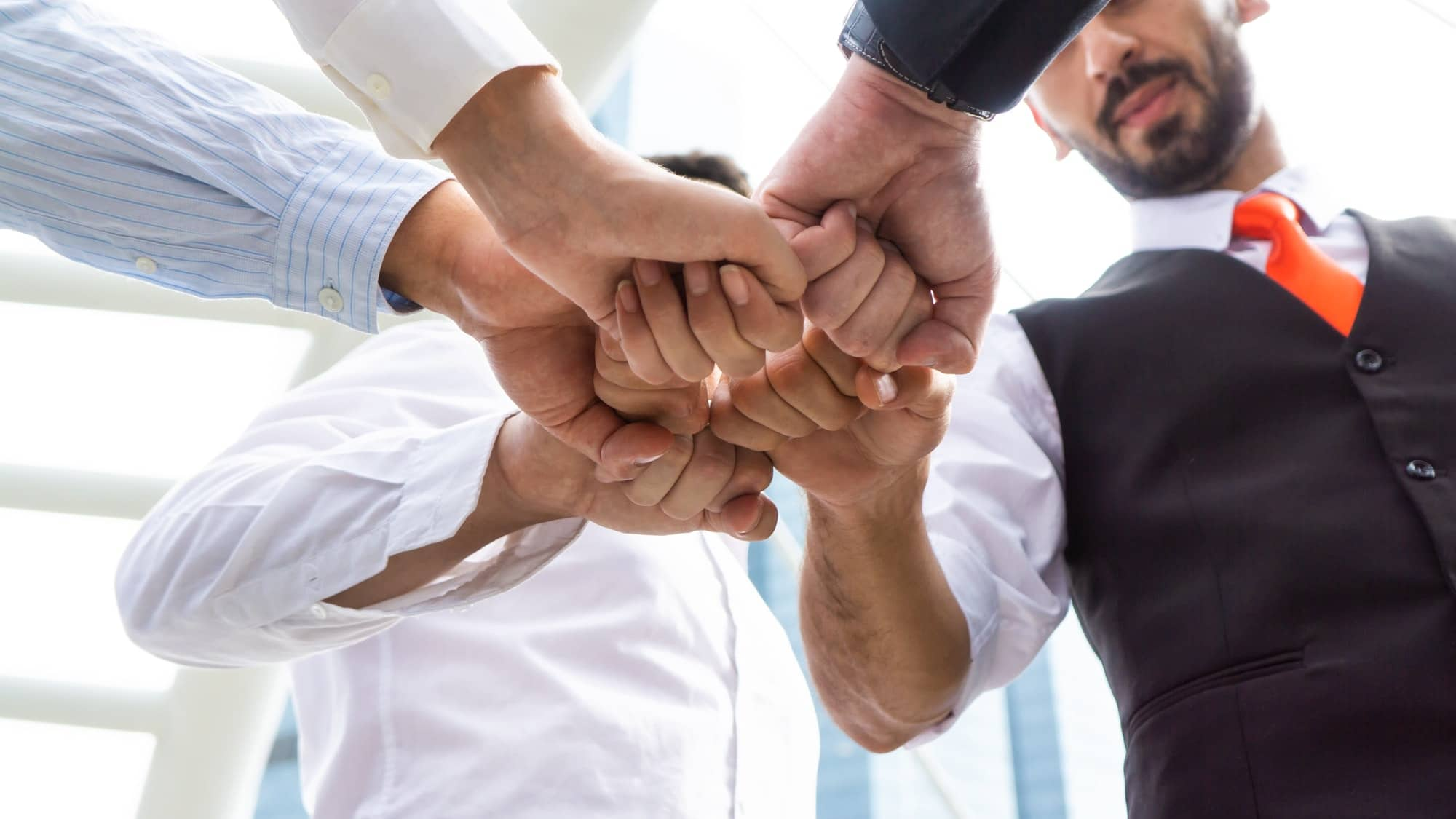 Business people doing fists pump as unity