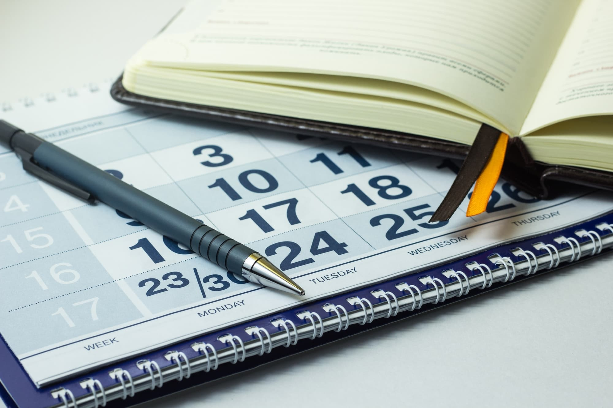 Business notebook on the calendar background